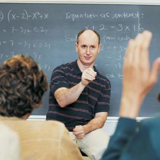 A teacher is teaching in front of a class of students.